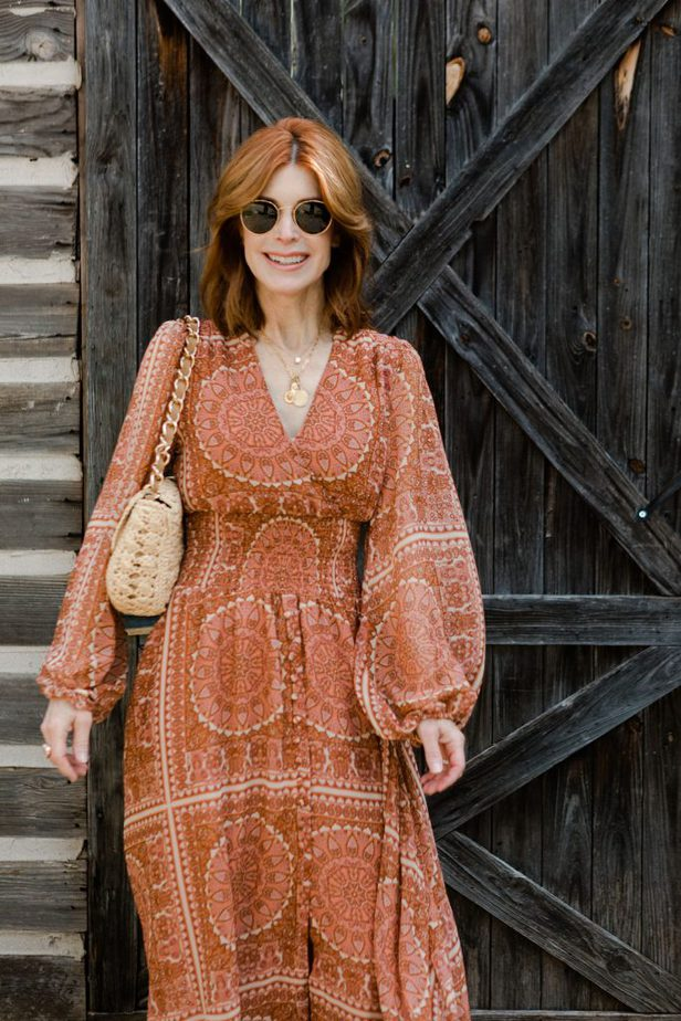 Cathy Williamson wearing orange dress from anthropologie
