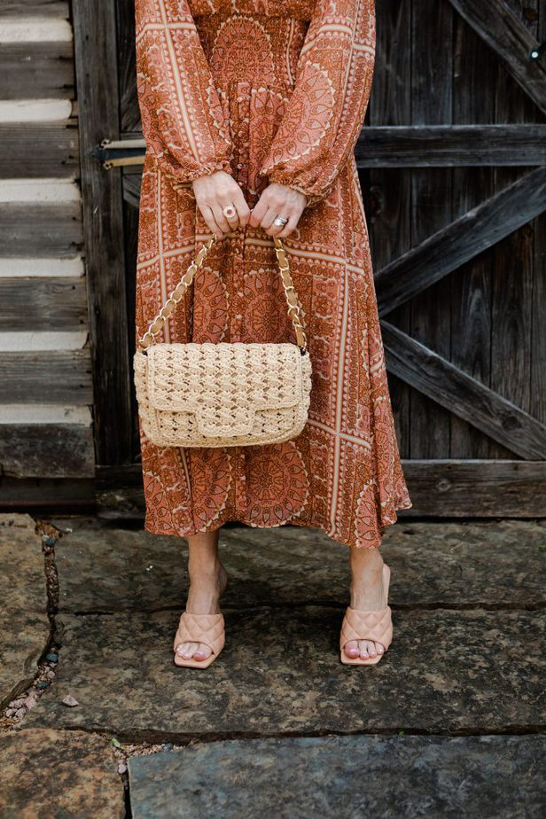 The Middle Page wearing Caterina Bertini woven bag with Orange Anthropologie dress and Bottega Venetta sandals