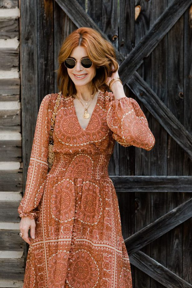 Cathy Williamson wearing an orange dress from Anthropologie