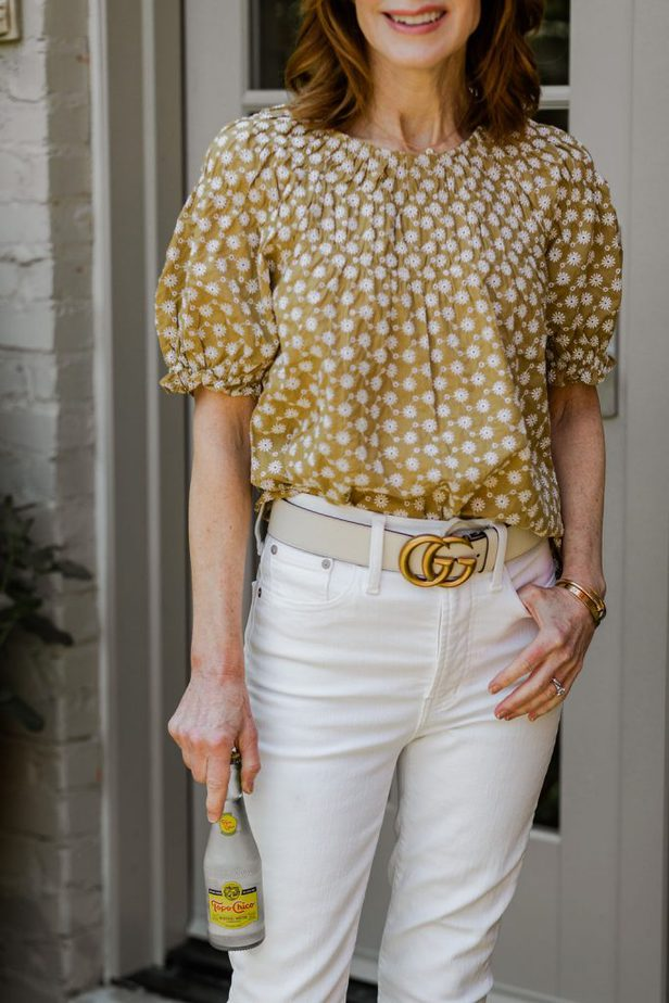 The Middle Page wearing yellow puff sleeve blouse from Madewell with White Denim jeans