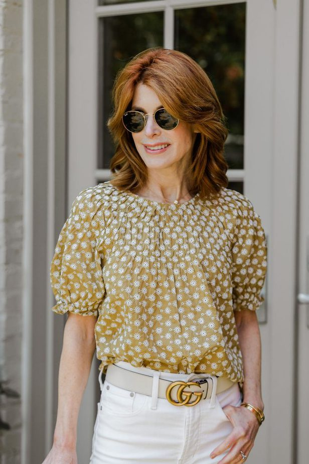 The Middle Page wearing white denim jeans with yellow puff sleeve blouse from Madewell