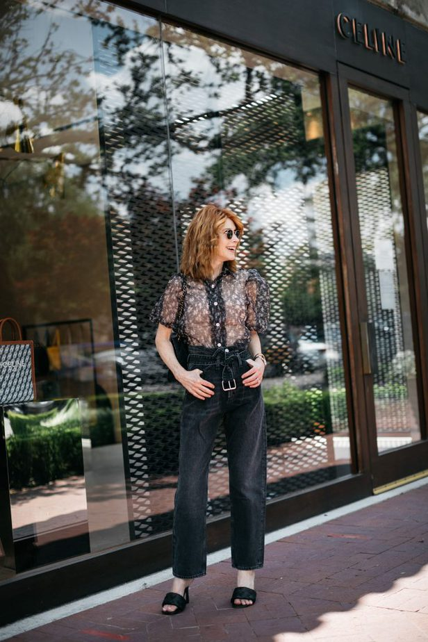 Black paperbag jeans and sheer top on blogger
