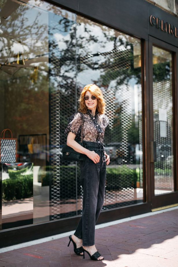 Dallas Blogger in Puff Sleeve Floral Blouse and Black Paperbag Denim