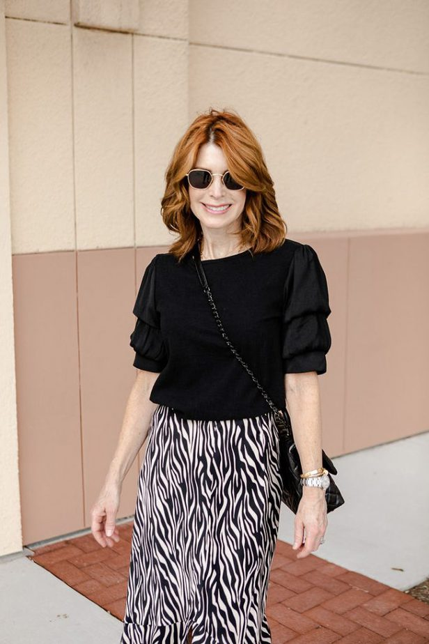 Black Top and Zebra Skirt with Ruffle on older Dallas blogger