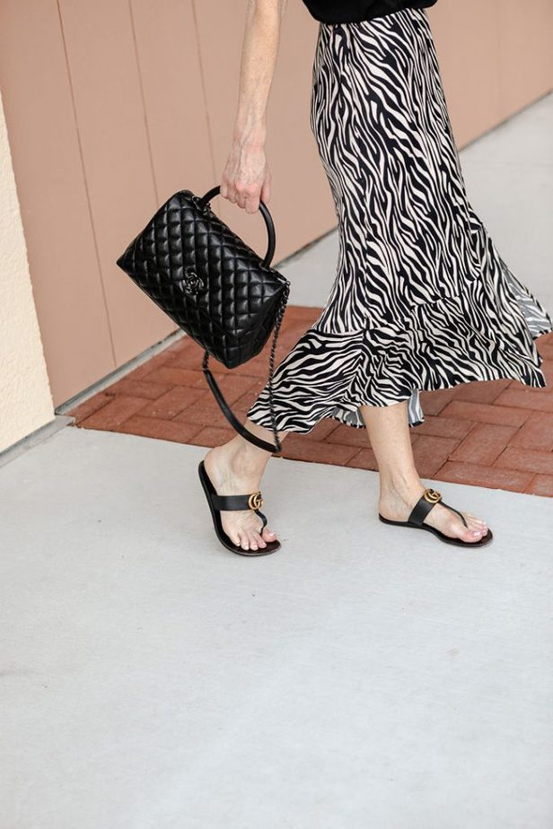 Grained Calfskin Chanel Bag with Black Metal with zebra skirt on Dallas blogger