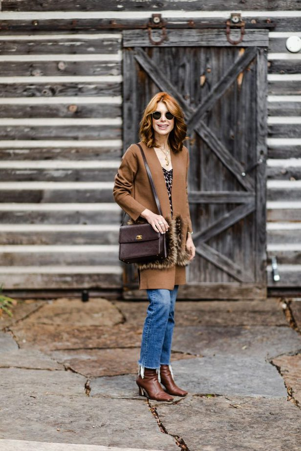 Red Head blogger in camel sweater with fur pockets for Thanksgiving day look