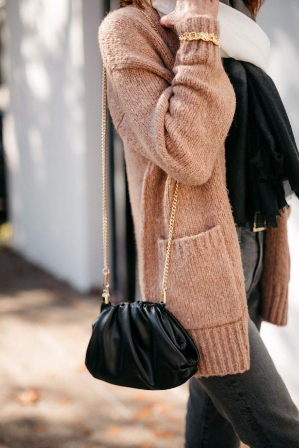 camel sweater and black dumpling sling bag