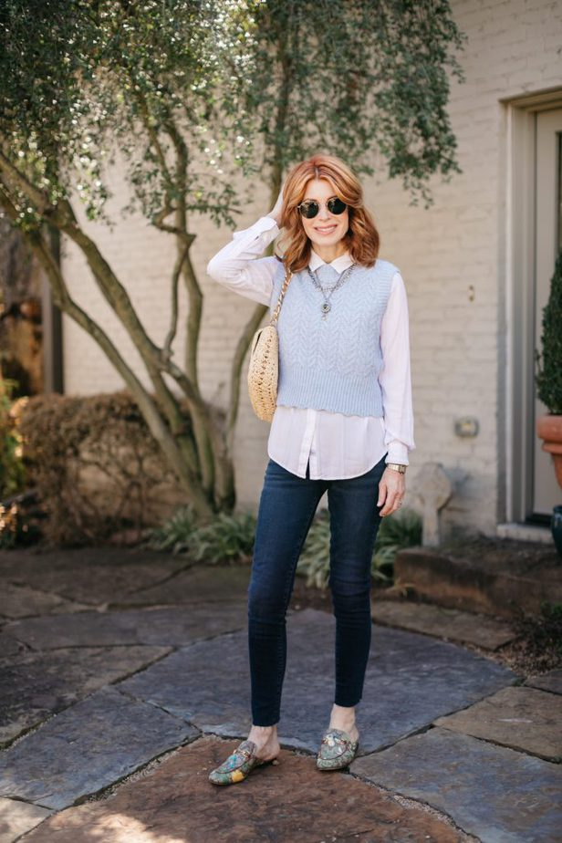 Red-haired blogger in vest and jeans