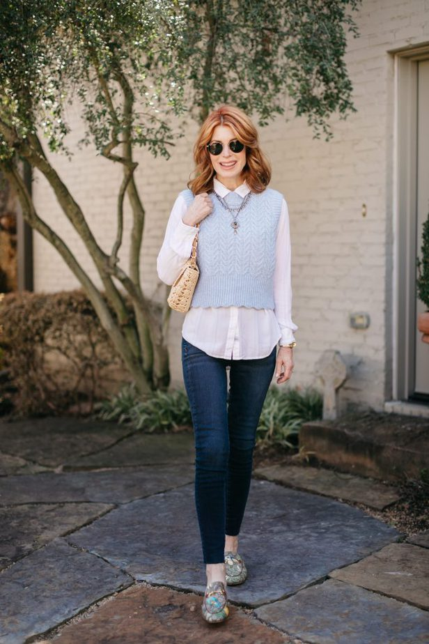 Older Dallas blogger in baby blue vest and jeans | bring back the sweater vest fashion