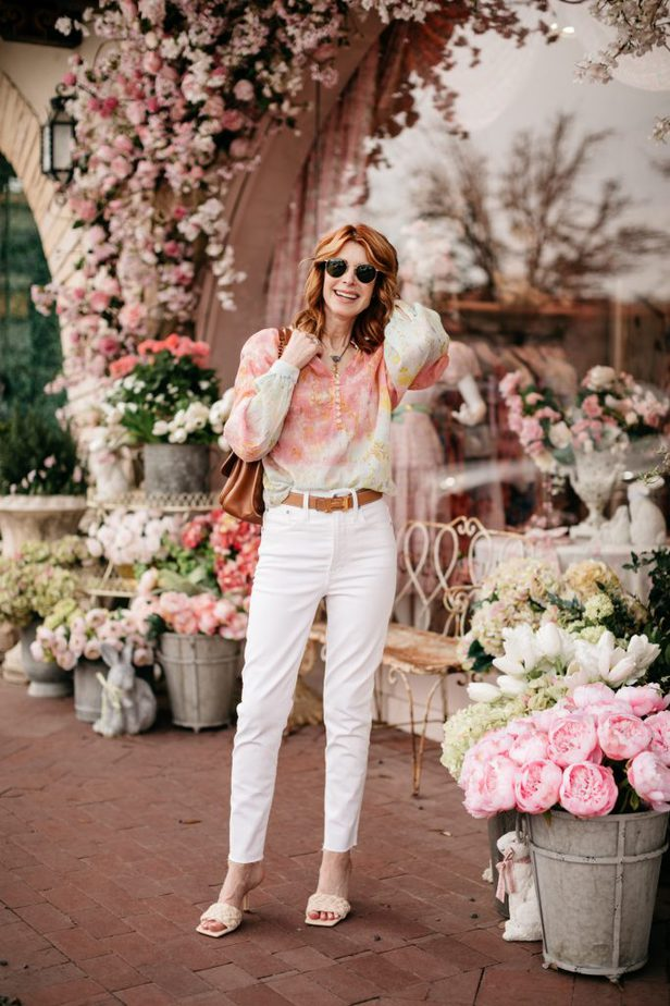 Fashionable woman wearing white pants and cotton candy color blouse