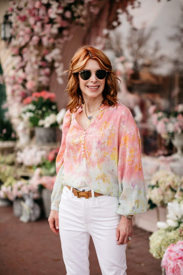 Closeup of a woman wearing a Red Head Dallas Blogger wearing a cotton candy color blouse