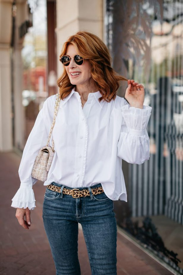 Dallas woman blogger wearing White Ruffle Shirt From Khaite, jeans, and sunglasses