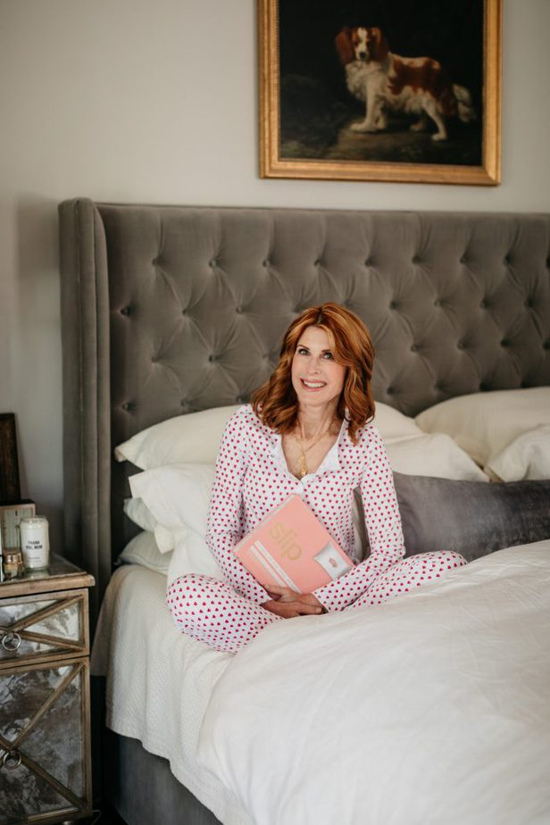 woman wearing polka dot sleepwear and sitting on a bed