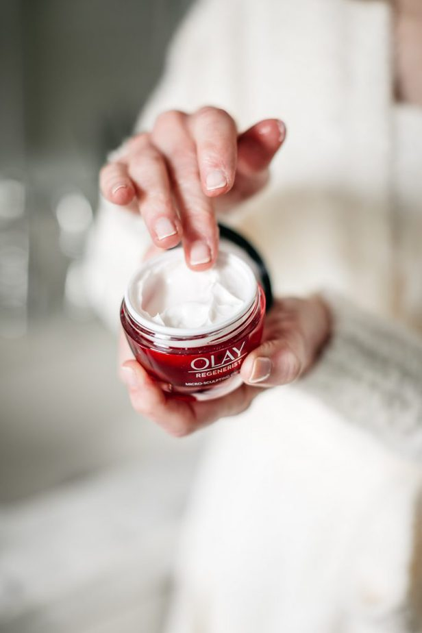 hand reaching inside an olay product