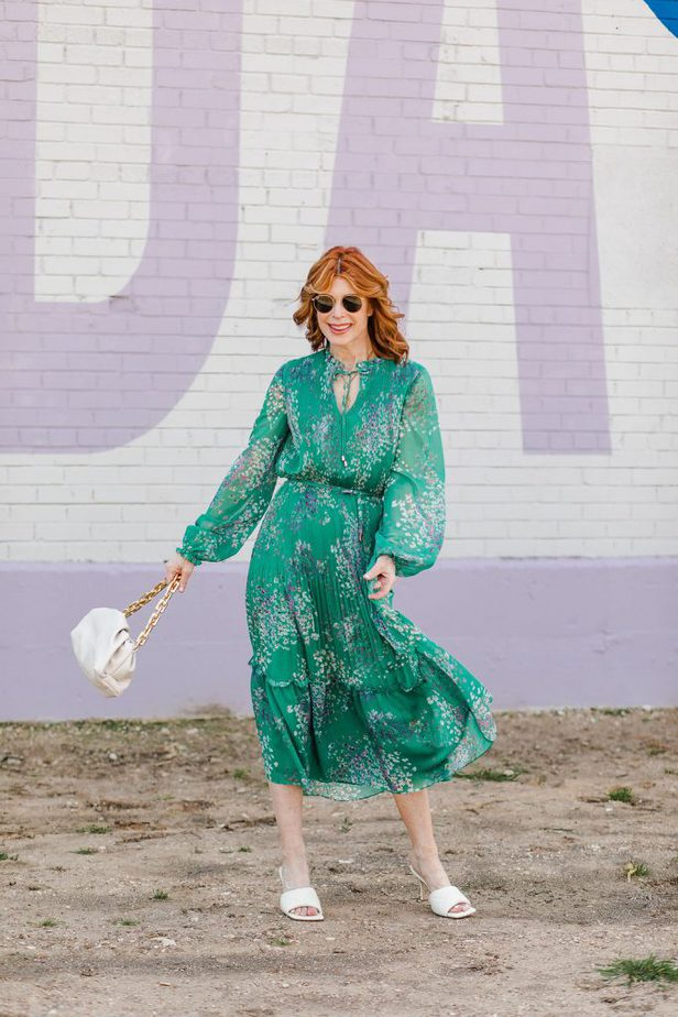 woman swaying wearing a green Perfect Multi-Occasion Dress