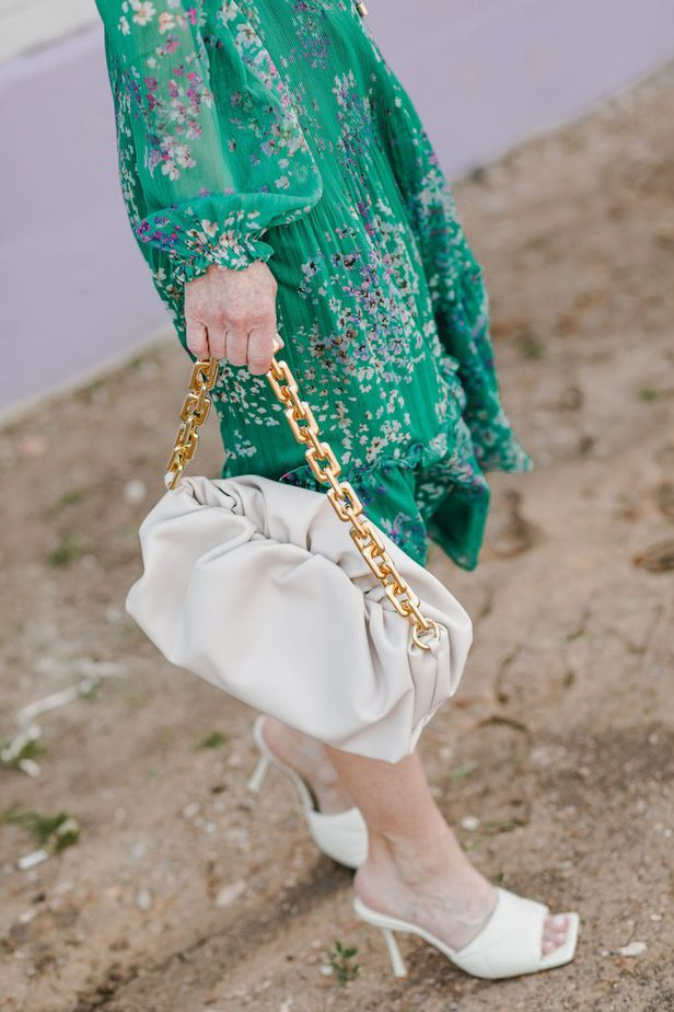 closeup photo of a woman's bag with gold chain