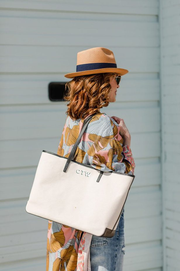back of a woman wearing adorable kimono, fedora hat and holding canvas bag from Leatherology