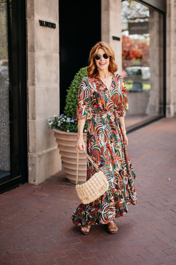Dallas Blogger in colorful print dress from Farm Rio and holding her bag