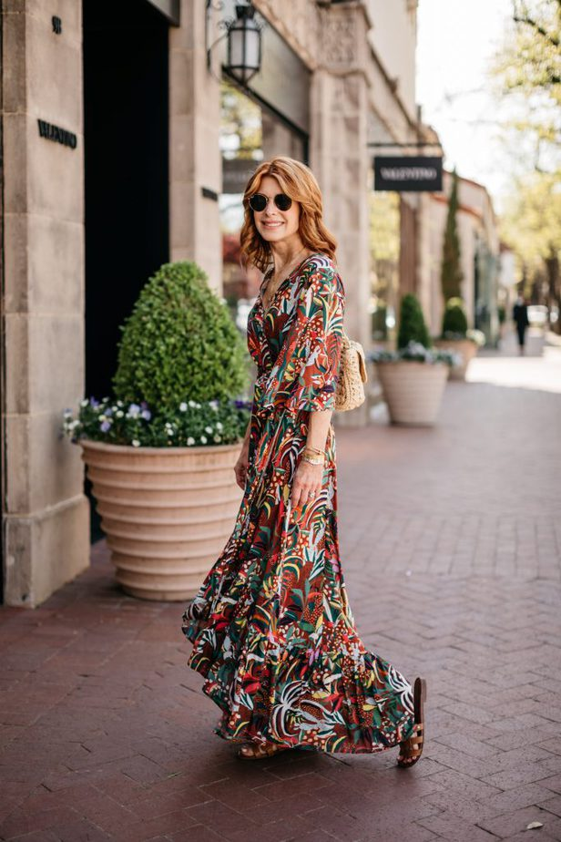 woman strutting the streets on a colorful farm rio dress