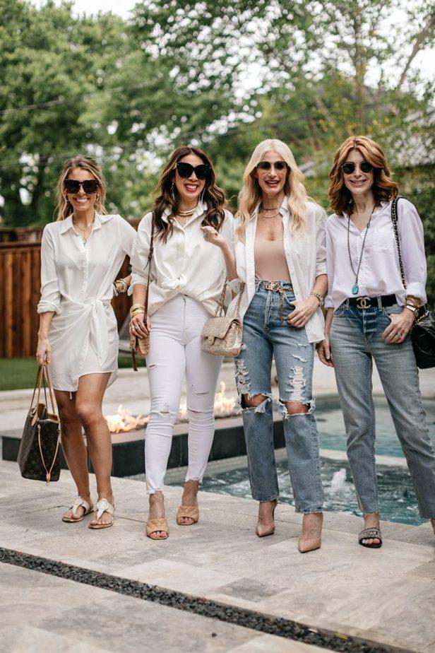 four women wearing White Button-Down shirts near the pool