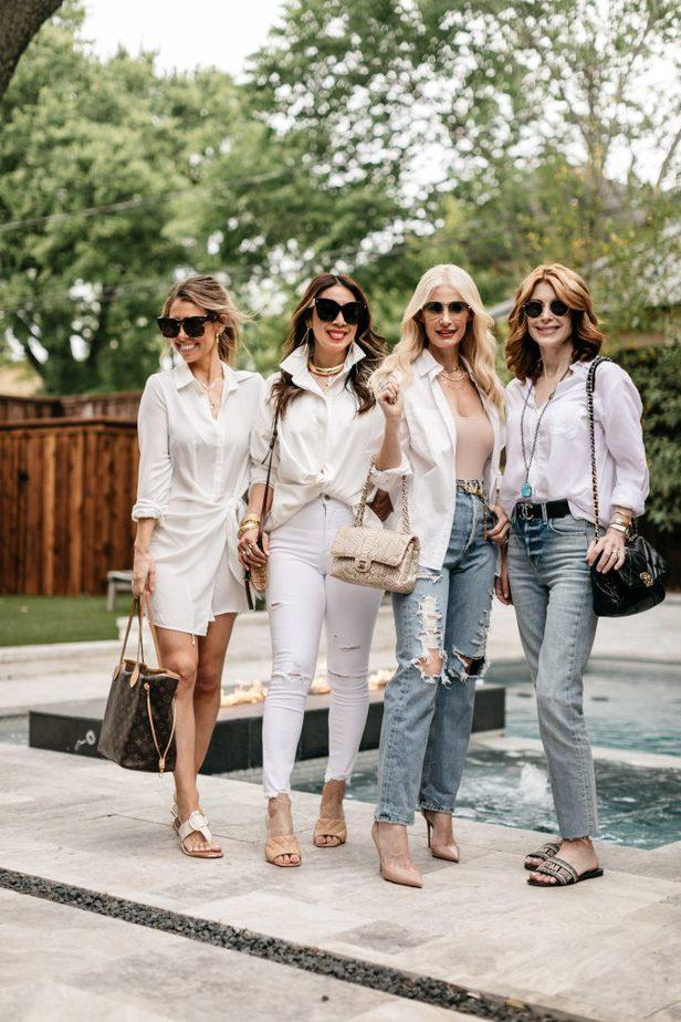 four women wearing White Button-Down near the pool