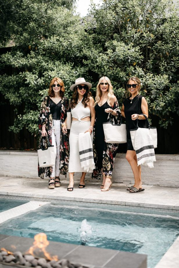 four women standing at the poolside for RACHEL ZOE