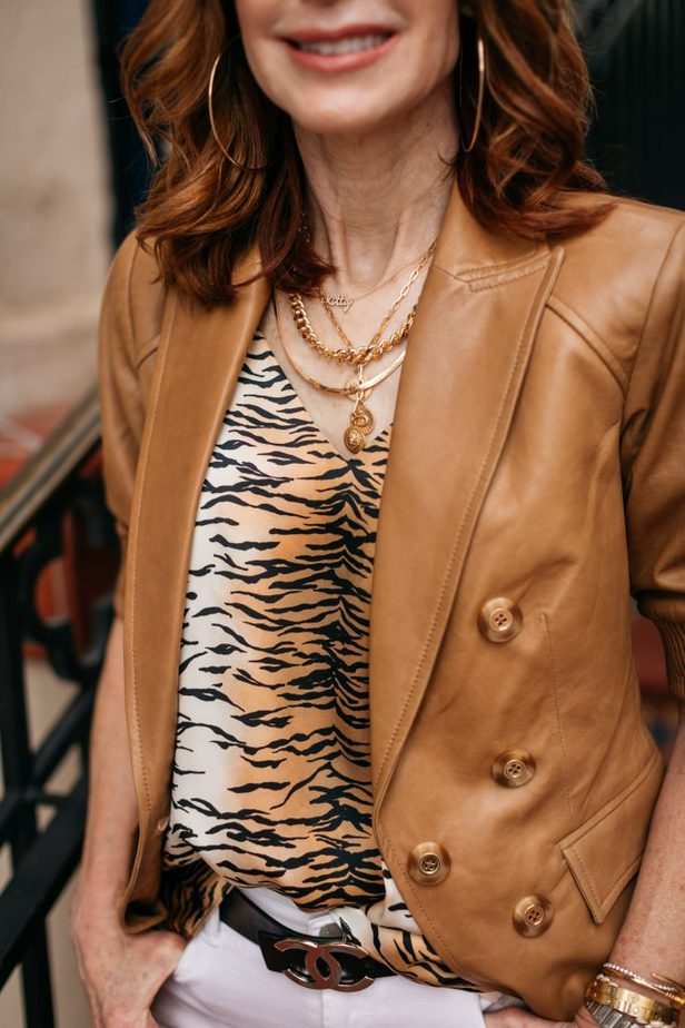 closeup of LEATHER BLAZER FOR THE SUMMER and animal print top