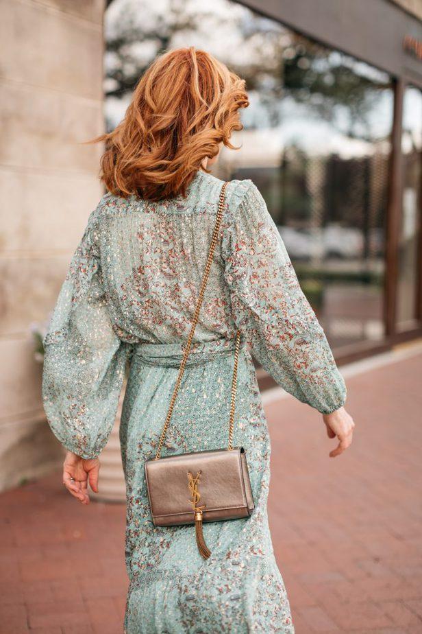 back detail of woman wearing mint dress for wedding season