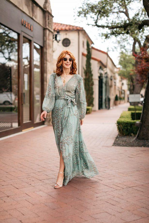 woman walking the street wearing dress for wedding season