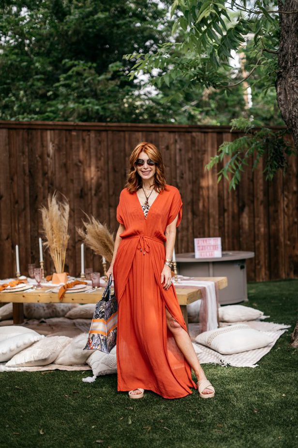 woman standing and wearing orange CHIC COVER-UP
