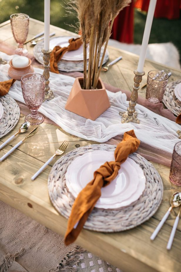 chic table setup with white plate and white and gold cutleries