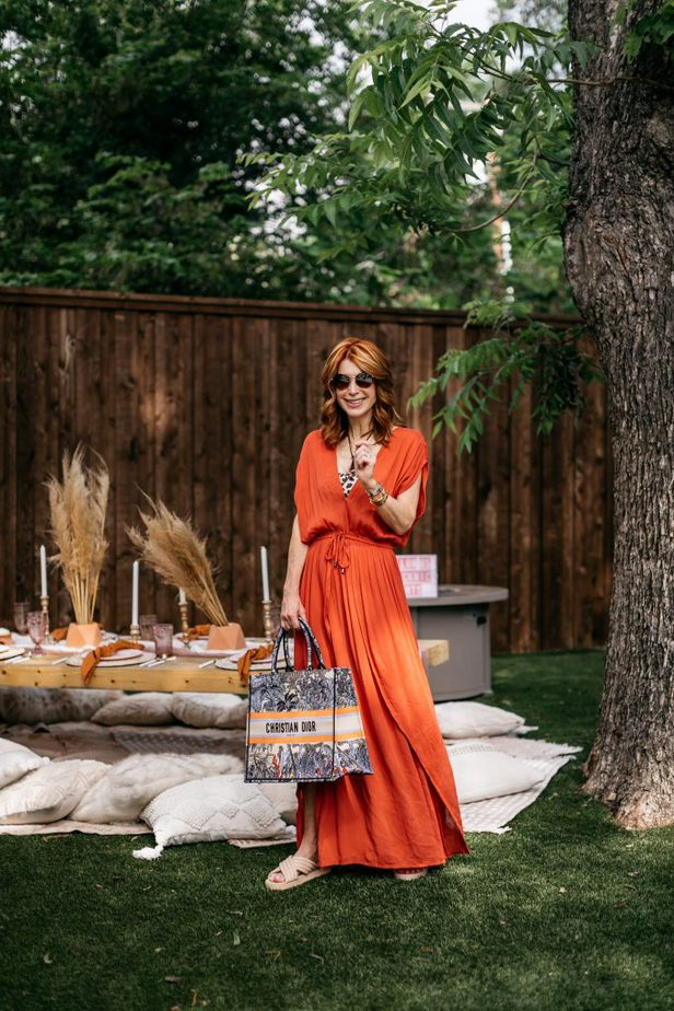 woman smiling and wearing orange CHIC COVER-UP