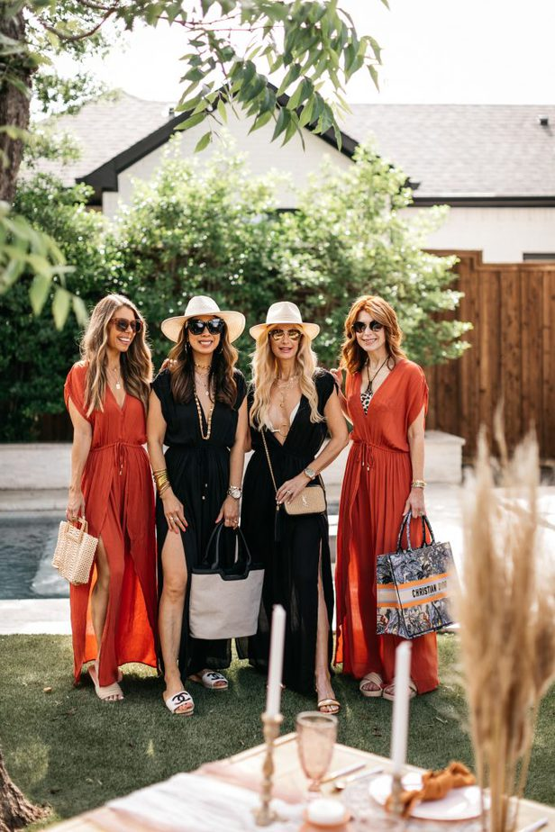 four women smiling and standing at the poolside wearing CHIC COVER-UP