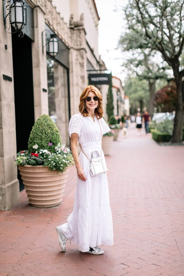 woman walking and wearing One of the Cool Summer Dresses in white