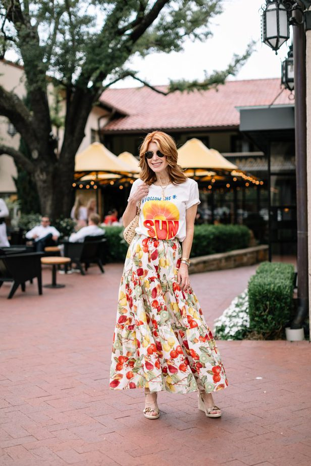 woman wearing Follow The Sun Tee and colorful skirt