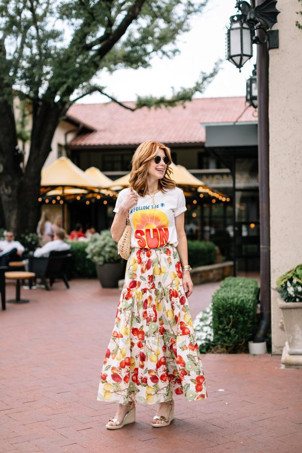 woman wearing tee, colorful skirt, and platforms sandals