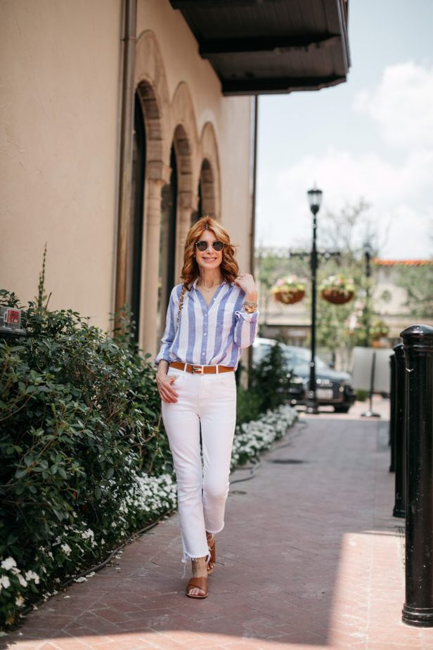woman wearing CLASSIC STRIPED BUTTON-DOWN and white pants