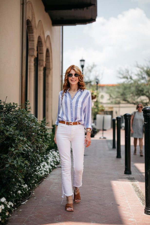 woman walking and wearing CLASSIC STRIPED BUTTON-DOWN and white pants