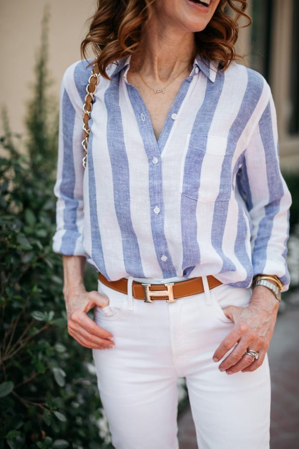 closeup image of woman wearing CLASSIC STRIPED BUTTON-DOWN and white pants