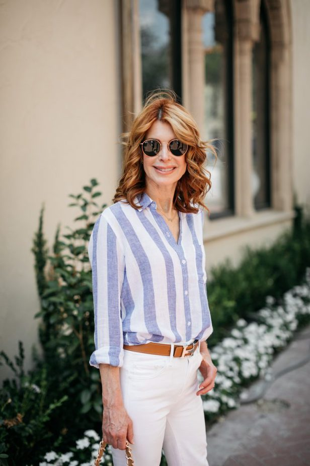 closeup of woman wearing a shirt and white pants