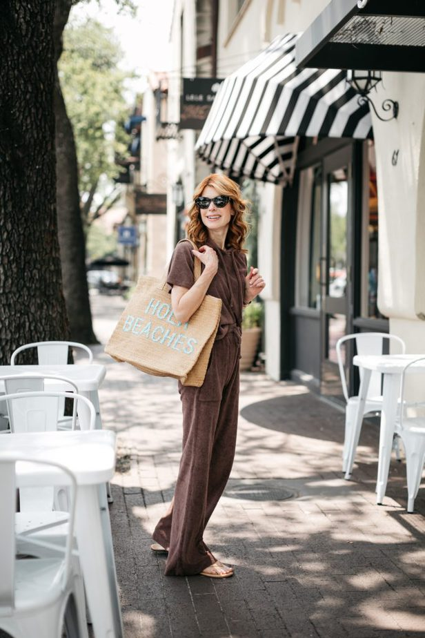 woman walking with hola beaches bag