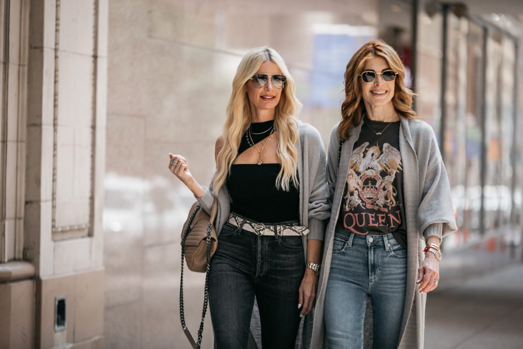 two women wearing sunglasses and wearing cardigans from the Nordstrom sale