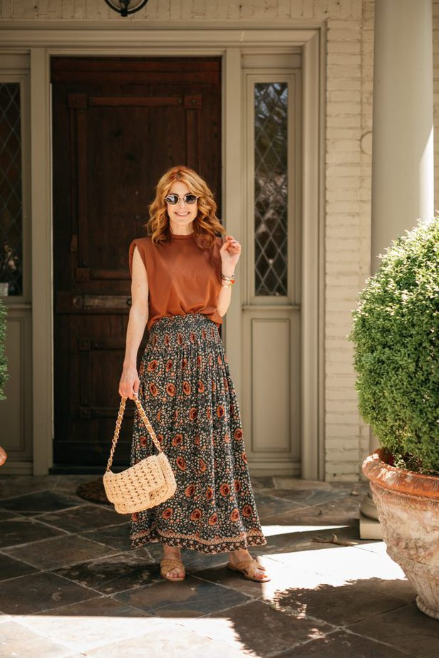 woman wearing padded shoulder tee and printed skirt