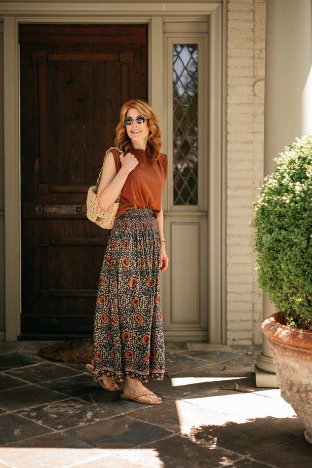 woman posing outside a door