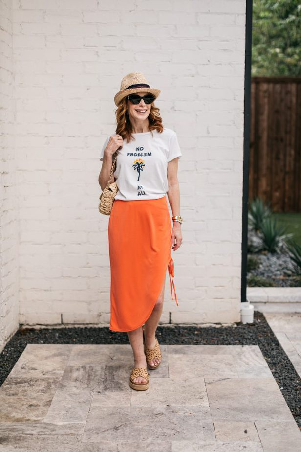 woman wearing orange skirt and white shirt
