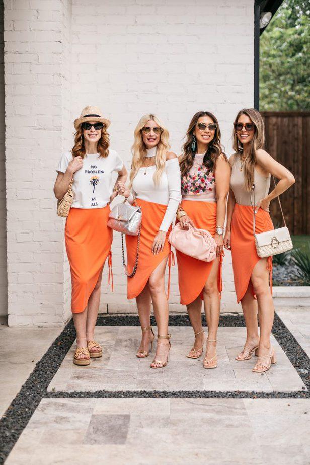 four women wearing orange skirt because It's Still Summer