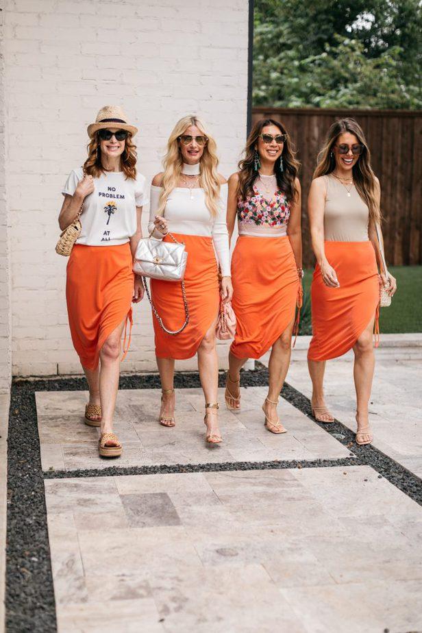four women walking and celebrating It's Still Summer