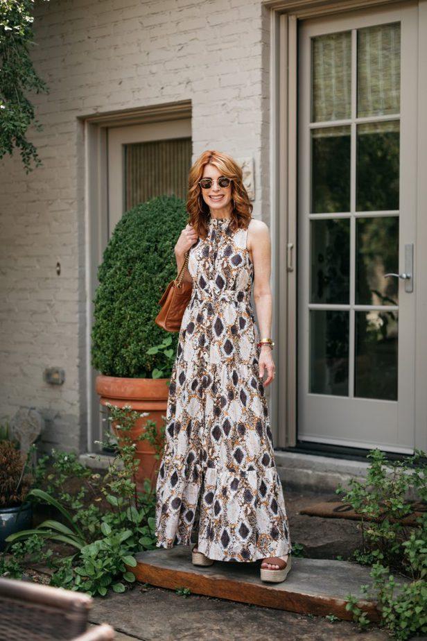 woman wearing SNAKE-PRINT MAXI DRESS