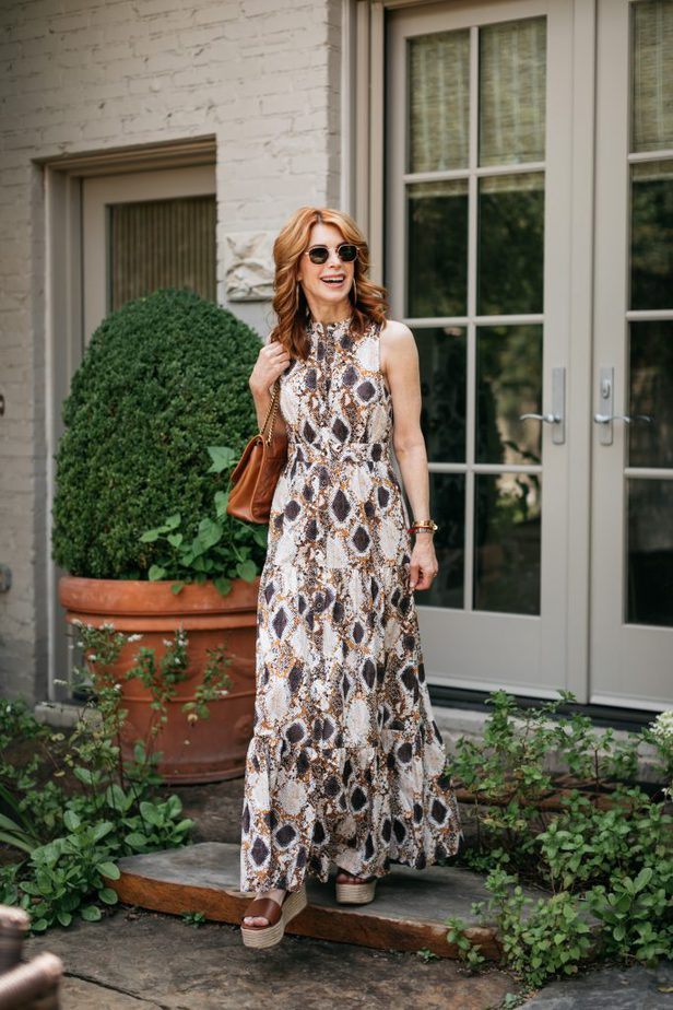 woman wearing printed dress and wedge sandals