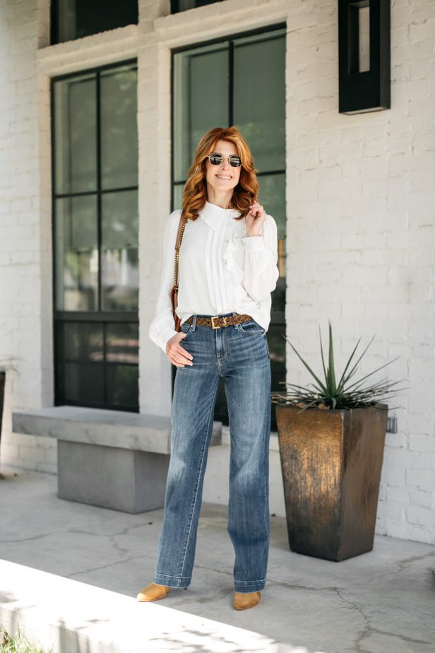 woman wearing jeans. blouse, and sunglasses